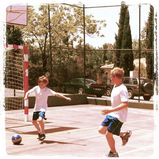 zac-and-his-mate-playing-football-at-club